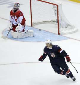 USA forward T.J. Oshie reacts after scoring the winning goal against Russia goaltender Sergei Bobrovski in a shootout during overtime of a men's ice hockey game at the 2014 Winter Olympics, Saturday, Feb. 15, 2014, in Sochi, Russia. (AP Photo/David J. Phillip )