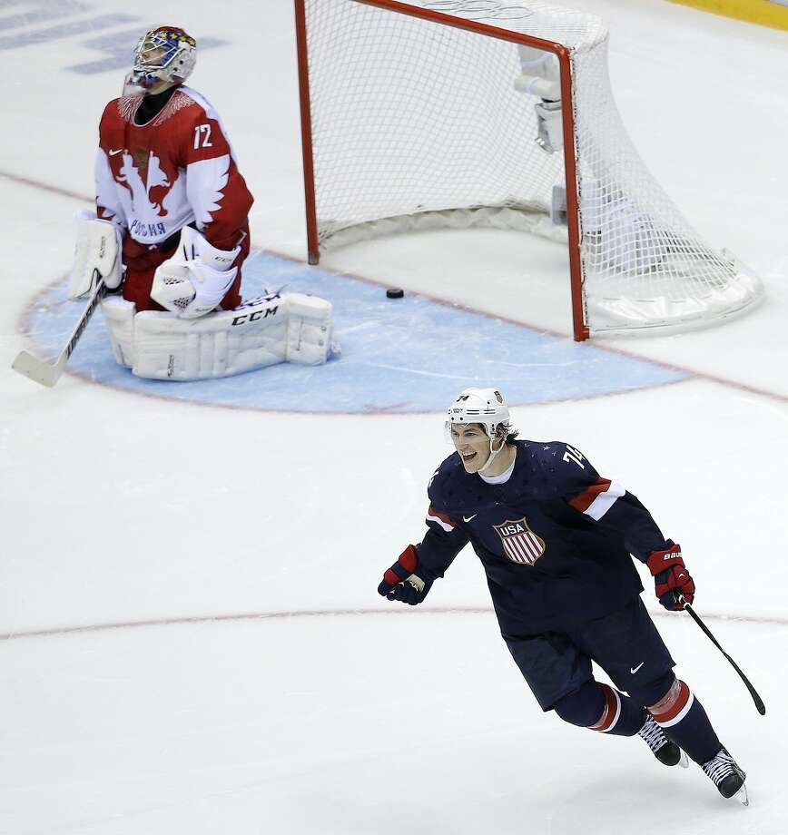 Team USA forward T.J. Oshie reacts after scoring the winning goal against Russian goaltender Sergei Bobrovsky in the eighth round of the shootout in Sochi. Photo: David J. Phillip, Associated Press