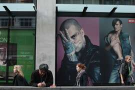 Advertisements loom over passersby on Market St. in San Francisco, Calif. on Thursday, Feb. 13, 2014.