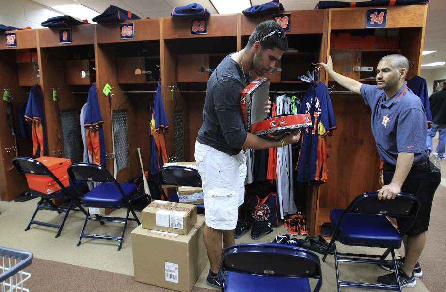J.D. Martinez of the Astros organizes his belongings after arriving at spring training. Photo: Karen Warren, Houston Chronicle