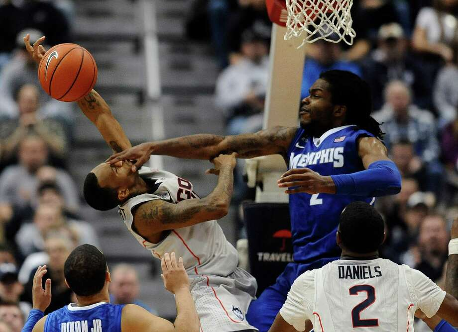 Memphis' Shaq Goodwin fouls Connecticut's Ryan Boatright, left, during the second half an NCAA college basketball game, Saturday, Feb. 15, 2014, in Hartford, Conn. Connecticut won 86-81 in overtime. (AP Photo/Jessica Hill) Photo: Jessica Hill, Associated Press / Associated Press