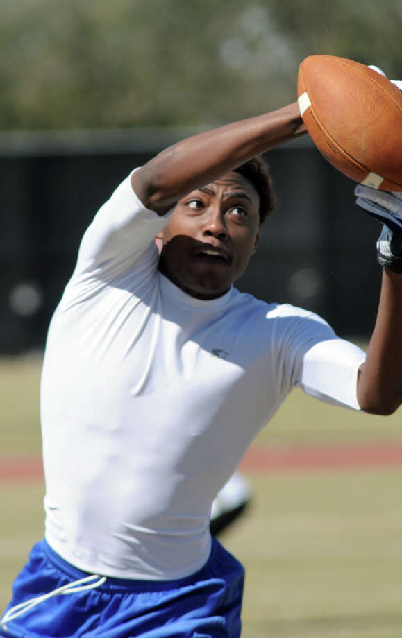 Lawrence Mallett, a wide receiver from Kipp Sunnyside High School, hauls in a pass during the 7 on 7 competition at the 6th Annual Greater Houston Senior Football Showcase at the Methodist Training center at Reliant Stadium on Saturday. Photo: Jerry Baker, For The Chronicle