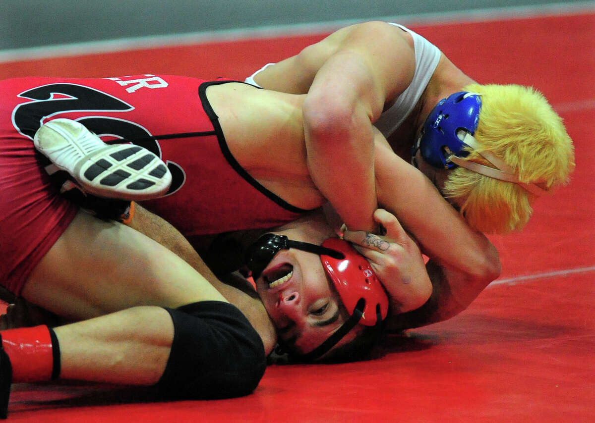 Danbury's Steven Beckham, top, wrestles against Fairfield Warde's Dylan Bender, during FCIAC Wrestling Championship action at New Canaan High School in New Canaan, Conn. on Saturday February 15, 2014.