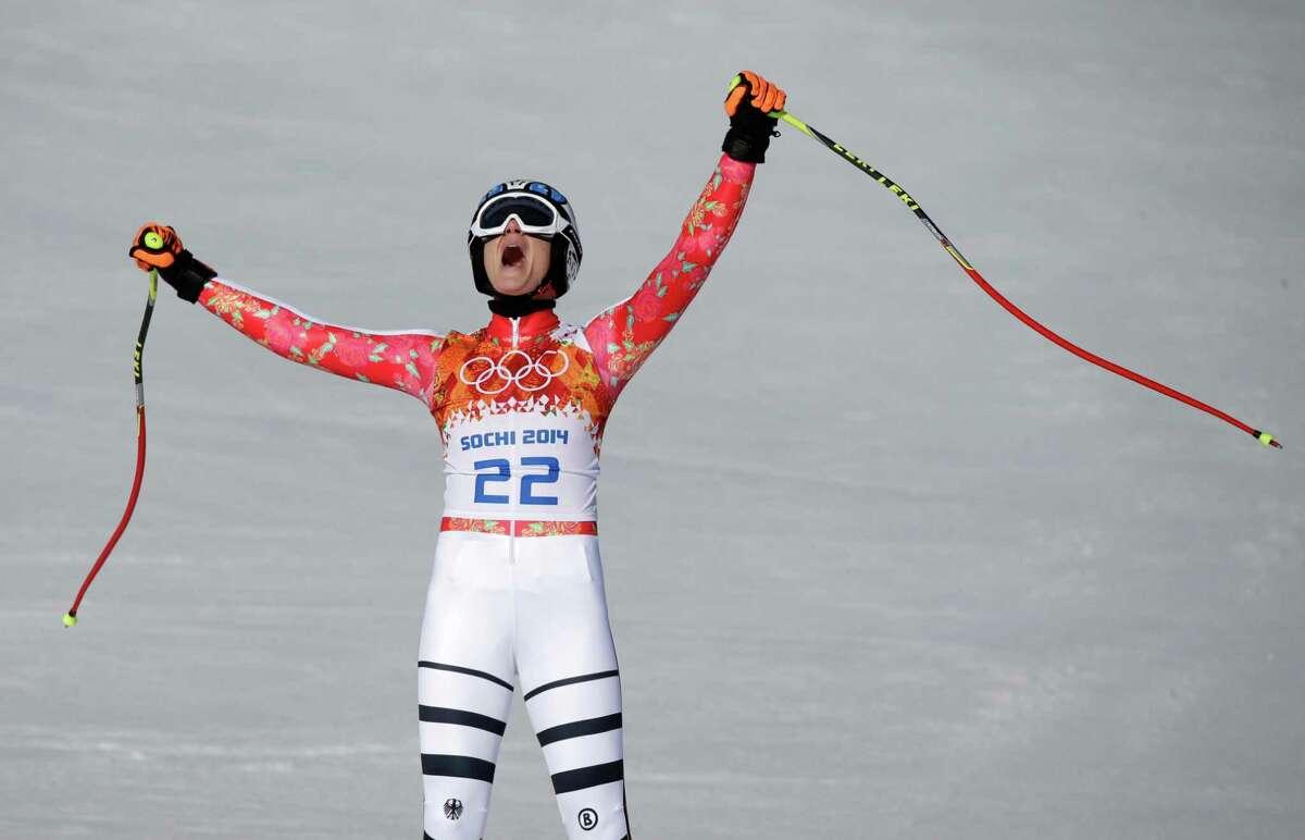 Germany's Maria Hoefl-Riesch celebrates after finishing the women's super-G at the Sochi 2014 Winter Olympics, Saturday, Feb. 15, 2014, in Krasnaya Polyana, Russia.