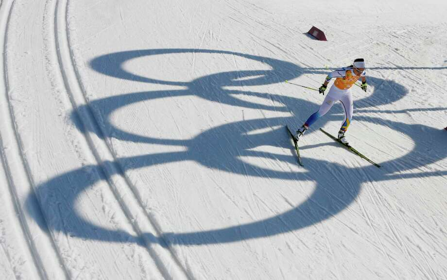 Sweden's Anna Haag skis past the Olympic rings during the women's 4x5K cross-country relay at the 2014 Winter Olympics, Saturday, Feb. 15, 2014, in Krasnaya Polyana, Russia. Photo: Dmitry Lovetsky, AP / AP2014