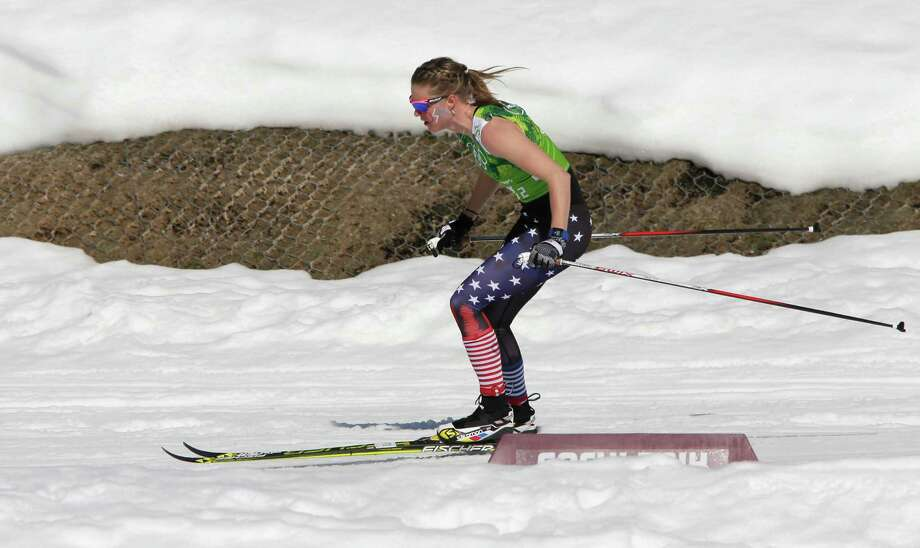 Sadie Bjornsen of the United States skis in a sleeveless top past a hole in the snow during the women's 4x5K cross-country relay at the 2014 Winter Olympics, Saturday, Feb. 15, 2014, in Krasnaya Polyana, Russia. Photo: Matthias Schrader, AP / AP