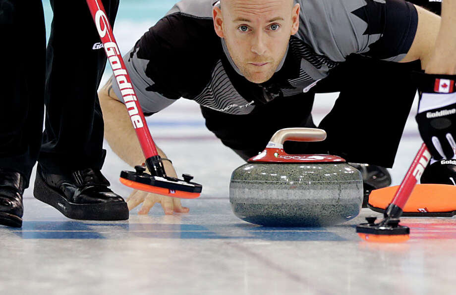 Canada's Ryan Fry releases the rock during the men's curling competition against Britain at the 2014 Winter Olympics, Saturday, Feb. 15, 2014, in Sochi, Russia. Photo: Wong Maye-E, AP / AP
