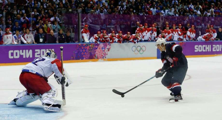 USA forward T.J. Oshie prepares to take a shot against Russia goaltender Sergei Bobrovski in an overtime shootout during a men's ice hockey game at the 2014 Winter Olympics, Saturday, Feb. 15, 2014, in Sochi, Russia. Oshie scored the winning goal and the USA won 3-2. Photo: Julio Cortez, AP / AP