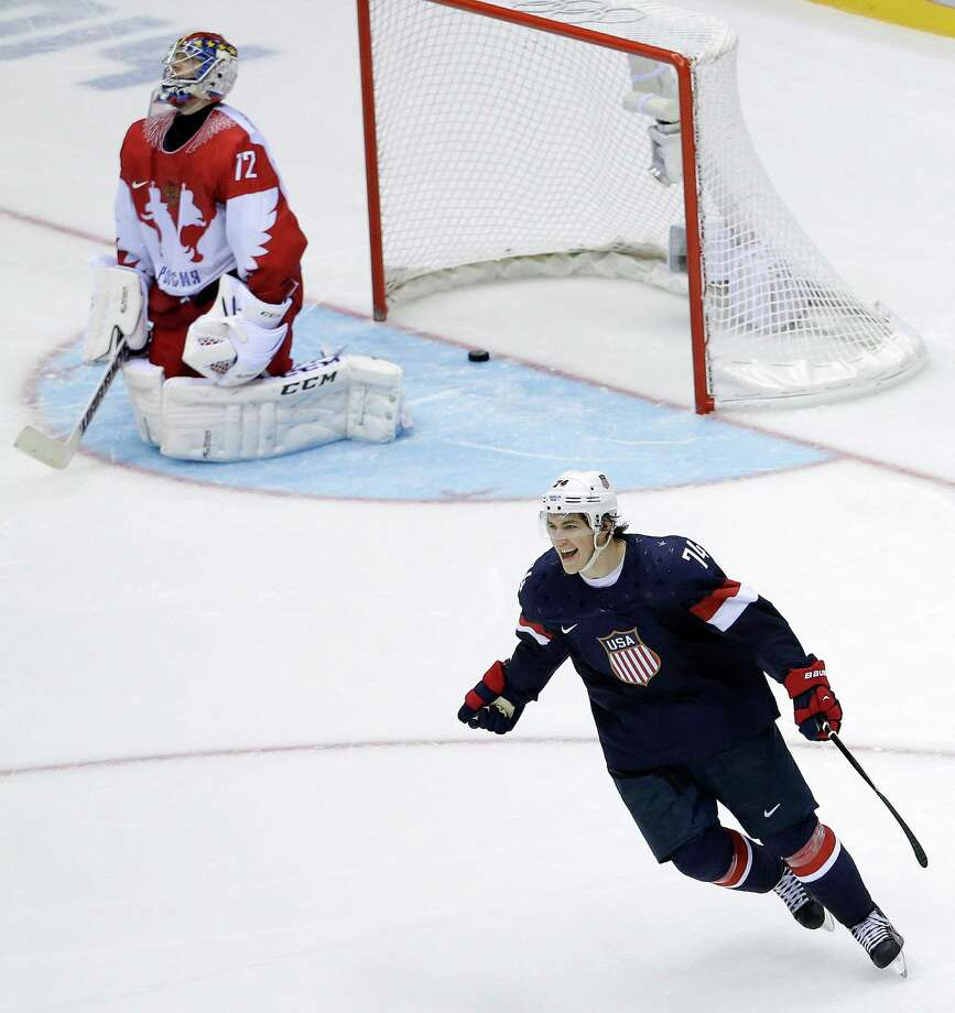 USA forward T.J. Oshie reacts after scoring the winning goal against Russia goaltender Sergei Bobrovski in a shootout during overtime of a men's ice hockey game at the 2014 Winter Olympics, Saturday, Feb. 15, 2014, in Sochi, Russia. Photo: David J. Phillip, AP / AP2014