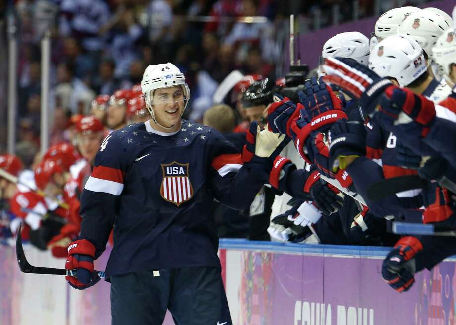 USA forward T.J. Oshie is greeted by treammates after scoring a goal during a shootout against Russia in overtime of a men's ice hockey game at the 2014 Winter Olympics, Saturday, Feb. 15, 2014, in Sochi, Russia. Photo: Mark Humphrey, AP / AP