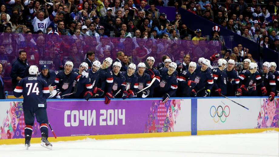 USA forward T.J. Oshie is greeted by teammates after scoring a goal against Russia during a shootout of a men's ice hockey game at the 2014 Winter Olympics, Saturday, Feb. 15, 2014, in Sochi, Russia. Photo: Julio Cortez, AP / AP