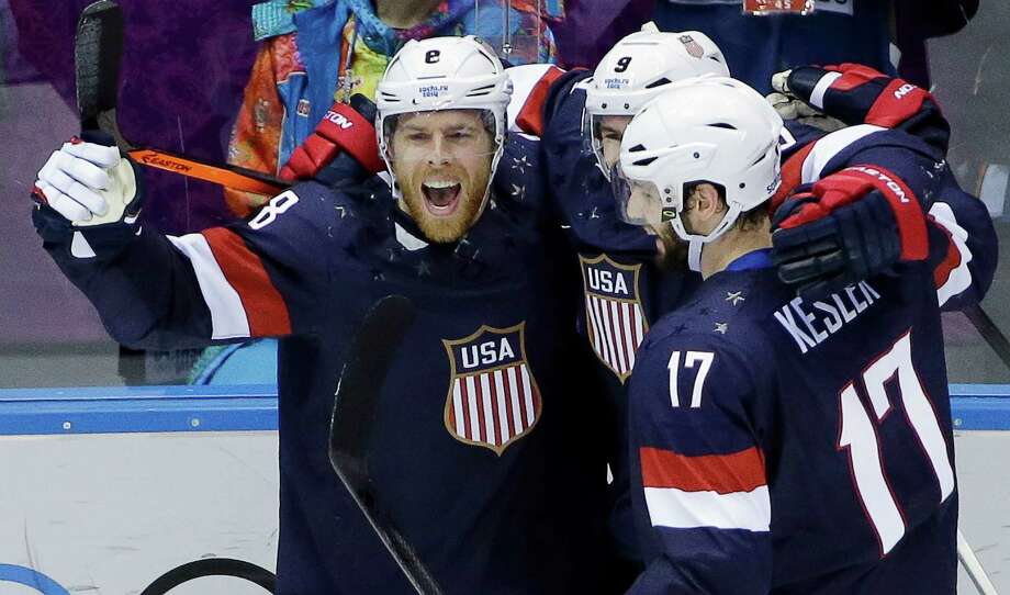 USA forward Joe Pavelski reacts with teammates after scoring a goal against Russia in the third period of a men's ice hockey game at the 2014 Winter Olympics, Saturday, Feb. 15, 2014, in Sochi, Russia. Photo: David J. Phillip, AP / AP2014