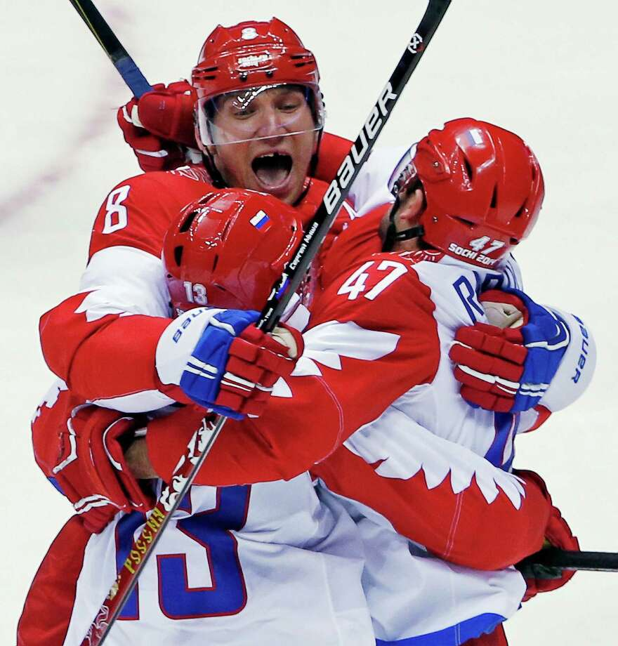 Russia forward Alexander Ovechkin reacts with forward Pavel Datsyuk after Datsyuk scored a third period goal against the USA during a men's ice hockey game at the 2014 Winter Olympics, Saturday, Feb. 15, 2014, in Sochi, Russia. Photo: Petr David Josek, AP / AP