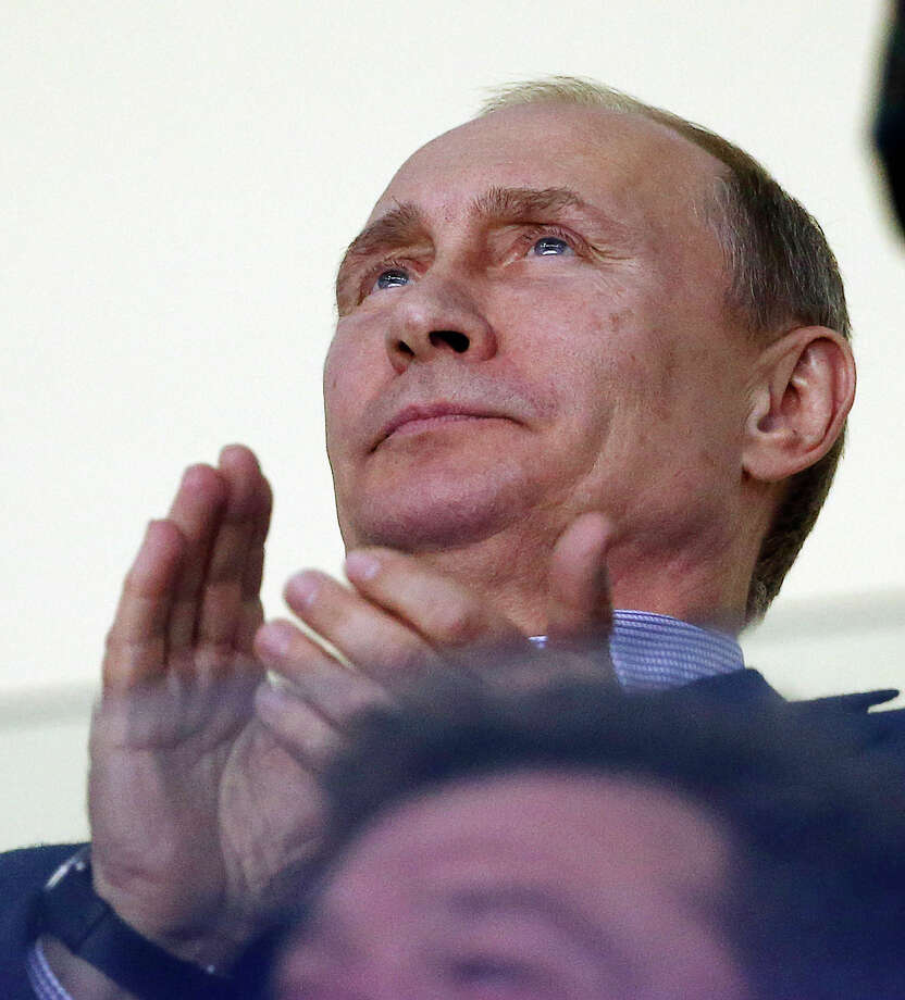 Russian President Vladimir Putin claps during the third period of a men's ice hockey game between the USA and Russia at the 2014 Winter Olympics, Saturday, Feb. 15, 2014, in Sochi, Russia. Photo: Petr David Josek, AP / AP2014