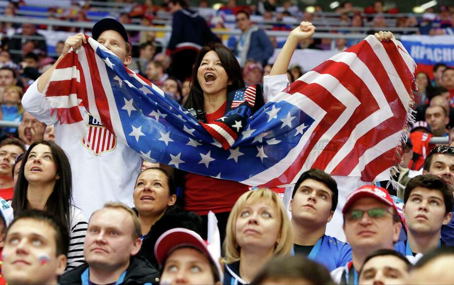 US fans cheer a second period goal by the USA against Russia during a men's ice hockey game at the 2014 Winter Olympics, Saturday, Feb. 15, 2014, in Sochi, Russia. Photo: Mark Humphrey, AP / AP