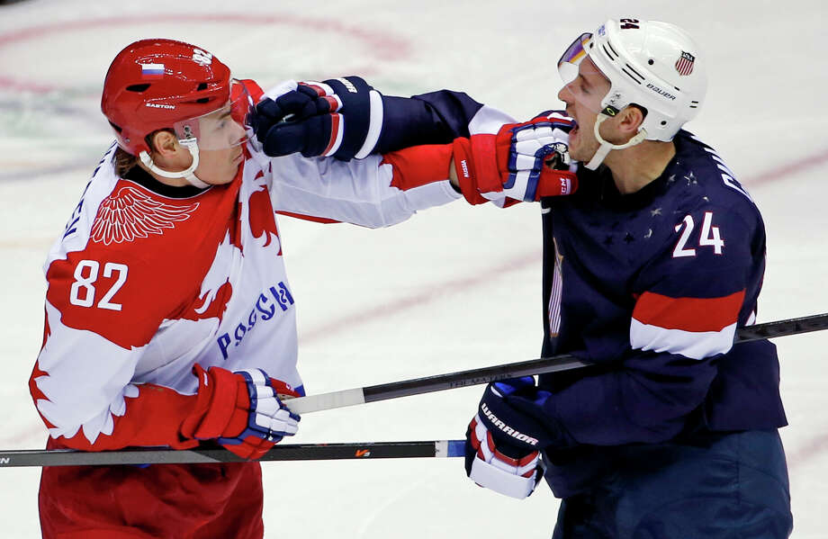 Russia defenseman Yevgeni Medvedev and USA forward Ryan Callahan shove each other in the first period of a men's ice hockey game at the 2014 Winter Olympics, Saturday, Feb. 15, 2014, in Sochi, Russia. Photo: Petr David Josek, AP / AP