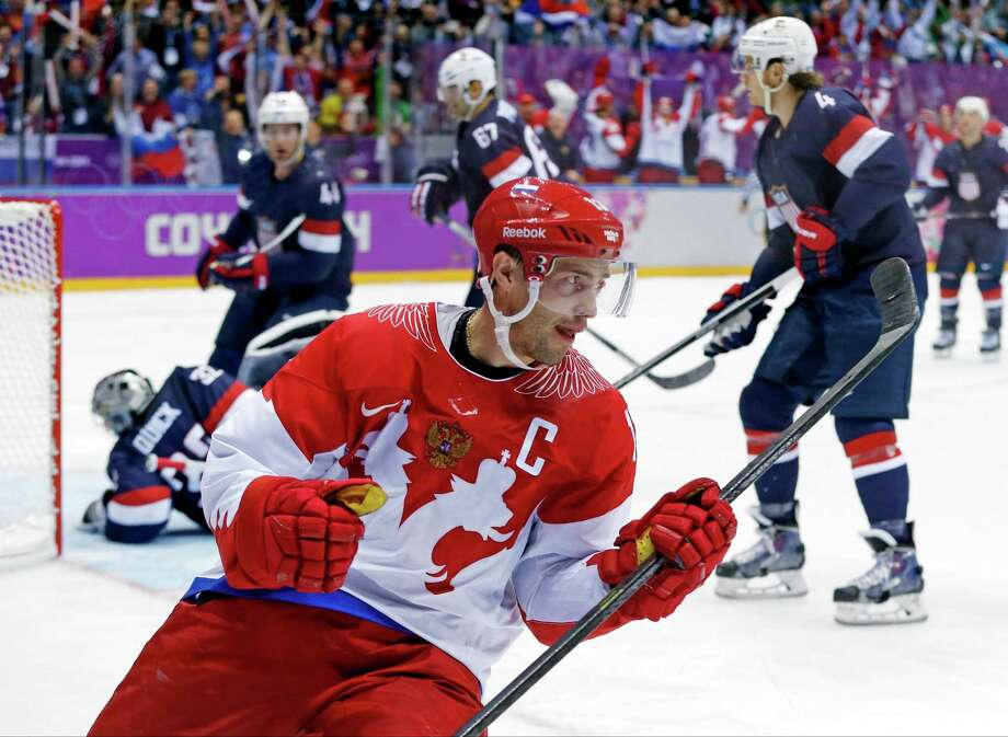Russia forward Pavel Datsyuk reacts after scoring a goal against the USA in the second period of a men's ice hockey game at the 2014 Winter Olympics, Saturday, Feb. 15, 2014, in Sochi, Russia. Photo: Julio Cortez, AP / AP2014