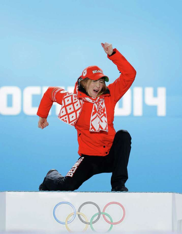Women's biathlon 15K individual gold medalist Darya Domracheva of Belarus celebrates during the medals ceremony at the 2014 Winter Olympics, Saturday, Feb. 15, 2014, in Sochi, Russia. Photo: David J. Phillip, AP / AP