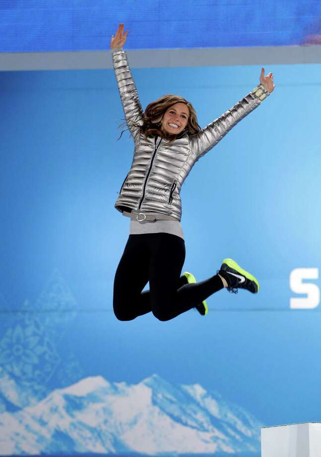Women's skeleton silver medalist Noelle Pikus-Pace of the United States jumps on the podium in celebration during the medals ceremony at the 2014 Winter Olympics, Saturday, Feb. 15, 2014, in Sochi, Russia. Photo: David J. Phillip, AP / AP