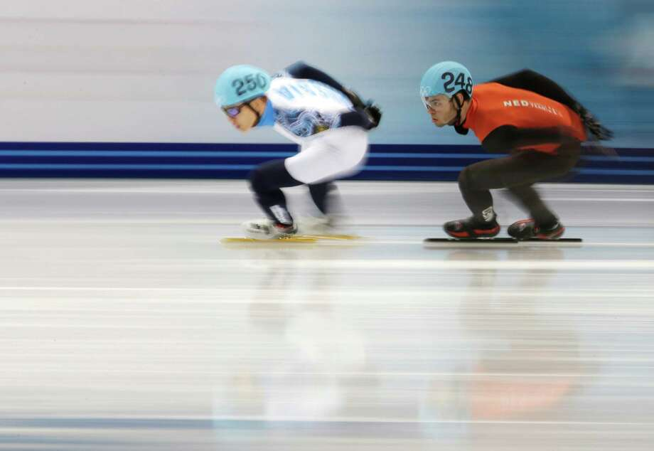 Victor An of Russia, left, and Sjinkie Knegt of Netherlands compete in a men's 1000m short track speedskating quarterfinal at the Iceberg Skating Palace during the 2014 Winter Olympics, Saturday, Feb. 15, 2014, in Sochi, Russia. Photo: Bernat Armangue, AP / AP