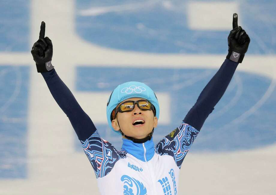 Victor An of Russia celebrates winning in a men's 1000m short track speedskating final at the Iceberg Skating Palace during the 2014 Winter Olympics, Saturday, Feb. 15, 2014, in Sochi, Russia. Photo: Vadim Ghirda, AP / AP
