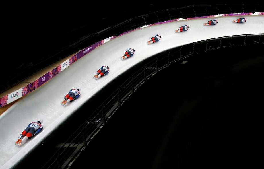In this image made with a multiple exposure, Yun Sung-bin of South Korea speeds down the track during the men's skeleton final competition at the 2014 Winter Olympics, Saturday, Feb. 15, 2014, in Krasnaya Polyana, Russia. Photo: Felipe Dana, AP / AP