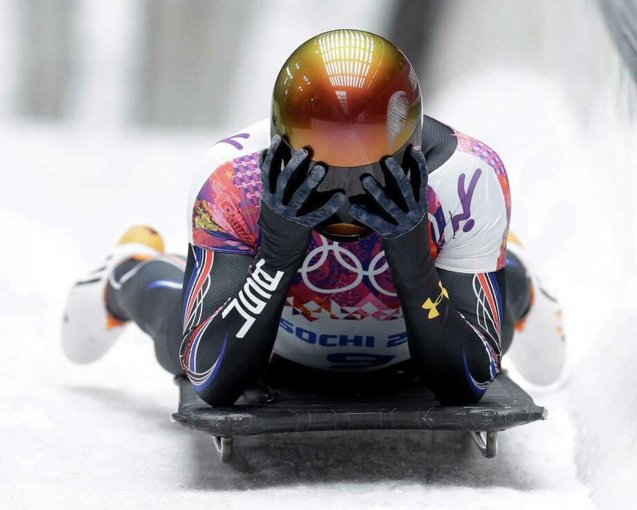 John Daly of the United States puts his head in his hands after a bad final run that dropped him out of medal contention during the men's skeleton competition at the 2014 Winter Olympics, Saturday, Feb. 15, 2014, in Krasnaya Polyana, Russia. Photo: Natacha Pisarenko, AP / AP2014