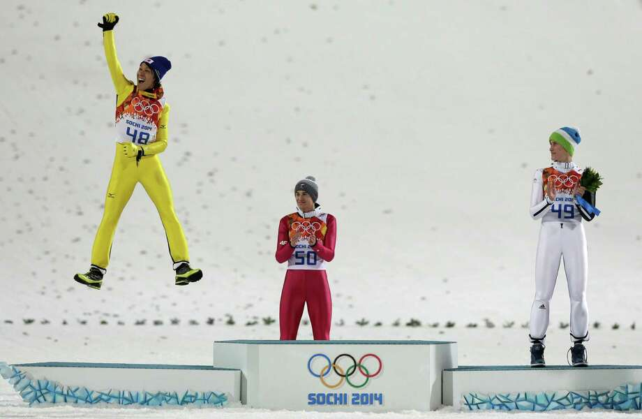 Japan's Noriaki Kasai celebrates winning the silver as Poland's gold medal winner Kamil Stoch and Slovenia's bronze medal winner Peter Prevc, from left, applaud during the flower ceremony after the ski jumping large hill final at the 2014 Winter Olympics, Saturday, Feb. 15, 2014, in Krasnaya Polyana, Russia. Photo: Matthias Schrader, AP / AP