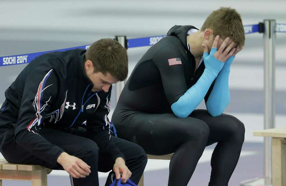 U.S. speed skater Joey Mantia, right, holds his head after the men's 1500-meter race at the Adler Arena Skating Center at the 2014 Winter Olympics, Saturday, Feb. 15, 2014, in Sochi, Russia. U.S. skaters are looking to bounce back from an awful start to their Olympics by slipping back into their old suits that should have been made obsolete by new high-tech gear. Photo: Patrick Semansky, AP / AP2014