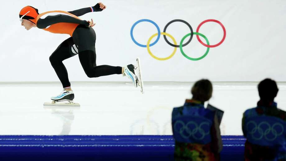 Silver medallist Koen Verweij of the Netherlands competes in the men's 1,500-meter speedskating race during the 2014 Winter Olympics in Sochi, Russia, Saturday, Feb. 15, 2014. Verweij lost the gold medal by three thousandth of a second. Photo: Pavel Golovkin, AP / AP