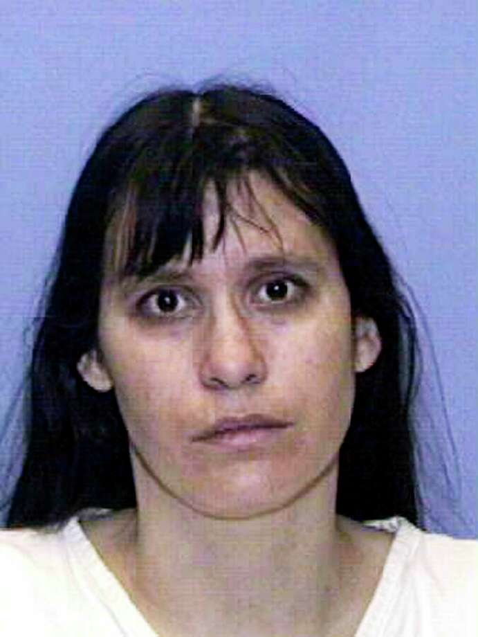 MARCH 21: (FILE PHOTO) Convicted child killer Andrea Yates is shown in this Texas Department of Criminal Justice handout photo March 21, 2002. Yates confessed to drowning her five children in a bathtub and was convicted on two counts of capital murder and sentenced to life in prison. A Texas Court of Criminal Appeals refused to reconsider a lower ruling that overturned the convictions of Yates on November 9, 2005 likely forcing a retrial of the case. (Photo by Texas Department of Criminal Justice via Getty Images) Photo: Handout / Getty Images North America