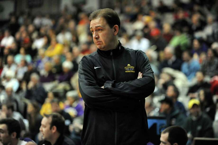 UAlbany's coach Will Brown wears a running suit to raise awareness about cystic fibrosis during their basketball game against Maine on Saturday, Feb. 15, 2014, at SEFCU Arena in Albany, N.Y. (Cindy Schultz / Times Union) Photo: Cindy Schultz / 00025704A