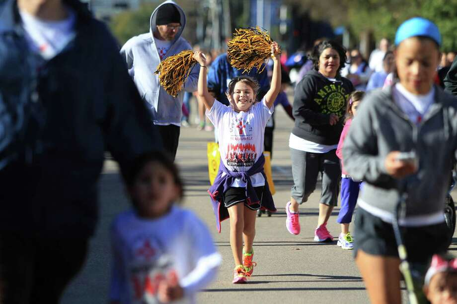Eleanor Seaton completes the 9th Annual Steps for Students David K. Guite Memorial 1K Family Fun Run at Co-Cathedral of the Sacred Heart on Saturday, Feb. 15, 2014, in Houston. Photo: Mayra Beltran, Houston Chronicle / © 2014 Houston Chronicle