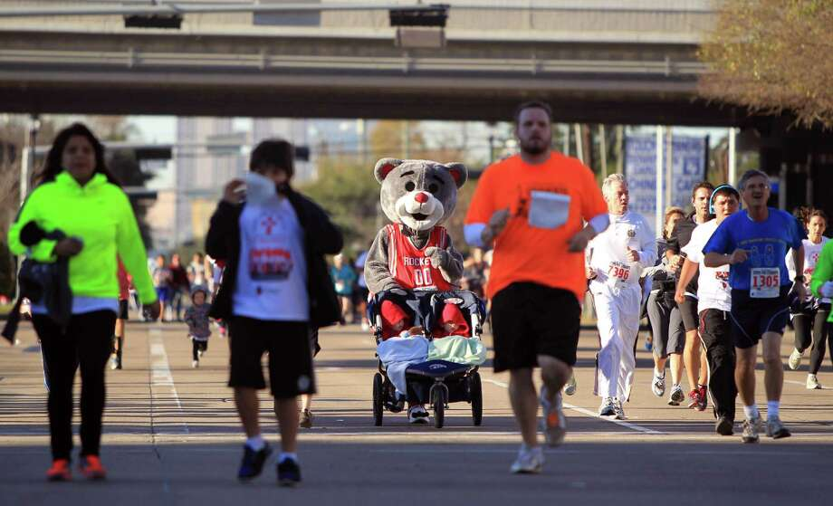 Thousands of walkers and runners, including Rocket's mascot, Clutch, participate in the 9th Annual Steps for Students 5K Run/ Walk and the David K. Guite Memorial 1K Family Fun Run at Co-Cathedral of the Sacred Heart on Saturday, Feb. 15, 2014, in Houston. Photo: Mayra Beltran, Houston Chronicle / © 2014 Houston Chronicle
