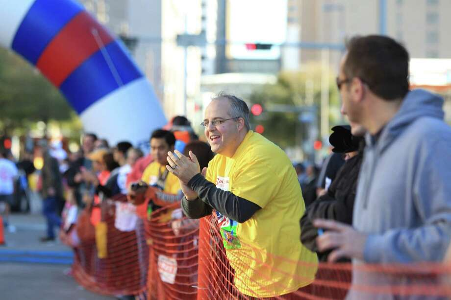 Thousands of walkers and runners participate in the 9th Annual Steps for Students 5K Run/ Walk and the David K. Guite Memorial 1K Family Fun Run at Co-Cathedral of the Sacred Heart on Saturday, Feb. 15, 2014, in Houston. Photo: Mayra Beltran, Houston Chronicle / © 2014 Houston Chronicle