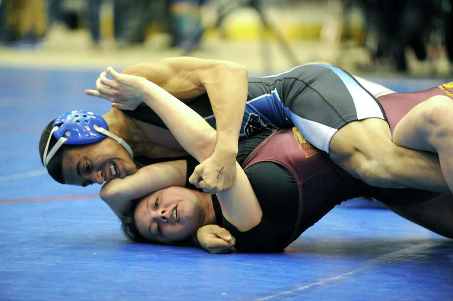 Luis Weierbach of Hoosick Falls goes for the pin as he wrestles Kelsey Gray of Fonda-Fultonville in the 120lb. class during the Section II Wrestling Tournament at the Glens Falls Civic Center on Saturday Feb. 15, 2014 in Glens Falls, N.Y. (Michael P. Farrell/Times Union) Photo: Michael P. Farrell / 00025764A