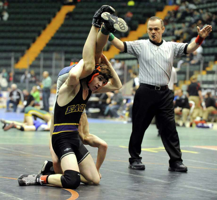Devin Van Vlack of Duanesburg wrestles Deven Lampron of Cobleskill in the 113lb. class during the Section II Wrestling Tournament at the Glens Falls Civic Center on Saturday Feb. 15, 2014 in Glens Falls, N.Y. Van Vlack won the match. (Michael P. Farrell/Times Union) Photo: Michael P. Farrell / 00025764A