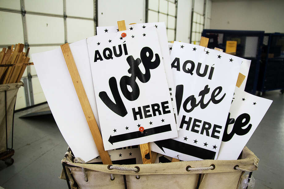 Voting signs at the Bexar County Elections Warehouse await distribution. Early voting starts Tuesday. Photo: Alma E. Hernandez, For The Express-News / San Antonio Express-News