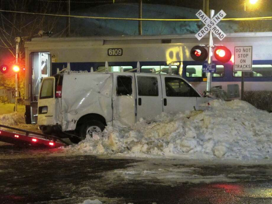 A Metro-North train on the Danbury branch struck a van at a railroad crossing near the Merritt 7 station in Norwalk on Saturday. The driver of the van reportedly suffered minor injuries. Photo: Wes Duplantier