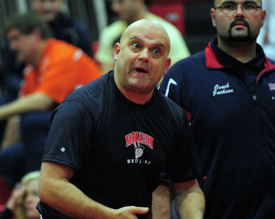 Brien McMahon's Head Coach Joe SantaLucia at FCIAC Wrestling Championship action at New Canaan High School in New Canaan, Conn. on Saturday February 15, 2014. Photo: Christian Abraham / Connecticut Post
