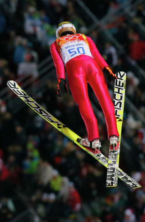 Poland's Kamil Stoch makes his first attempt during the ski jumping large hill final at the 2014 Winter Olympics, Saturday, Feb. 15, 2014, in Krasnaya Polyana, Russia. (AP Photo/Dmitry Lovetsky) ORG XMIT: OLYSJ166 Photo: Dmitry Lovetsky / AP