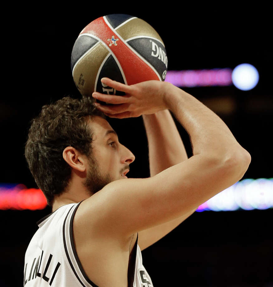 Marco Belinelli of the San Antonio Spurs shoots during the skills competition at the NBA All Star basketball game, Saturday, Feb. 15, 2014, in New Orleans. (AP Photo/Gerald Herbert) Photo: Gerald Herbert, Associated Press / AP