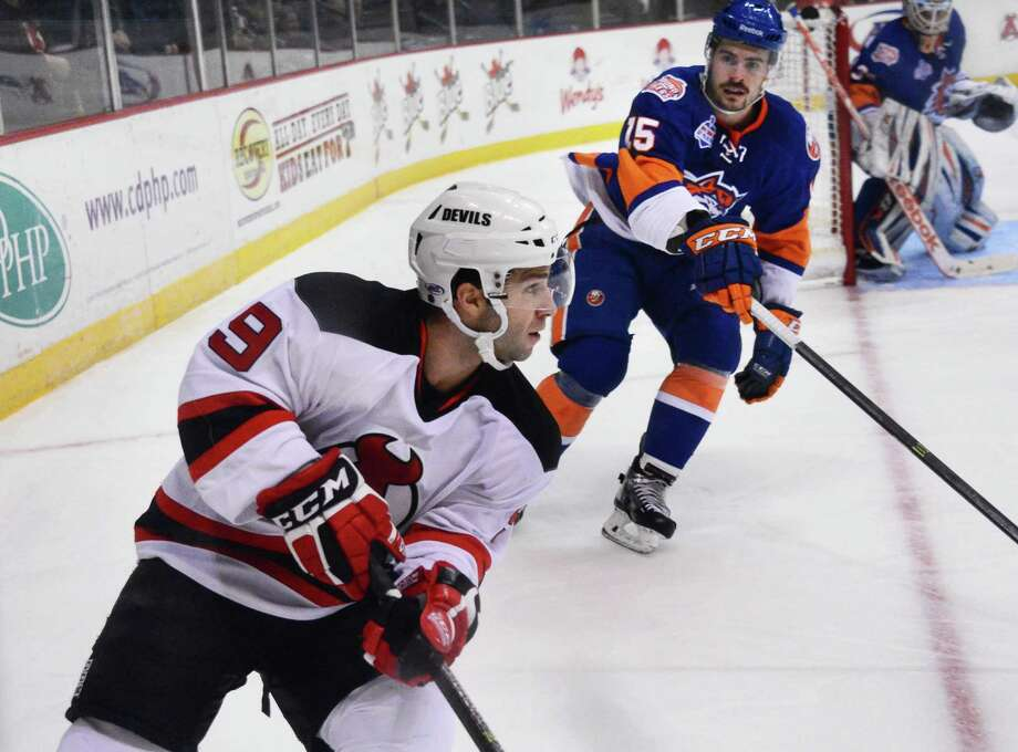 Albany Devils' #9 Joe Whitney, left, during Saturday's game against the Bridgeport Sound Tigers at the Times Union Center  Nov. 30, 2013, in Albany, NY.  (John Carl D'Annibale / Times Union) Photo: John Carl D'Annibale / 00024825A