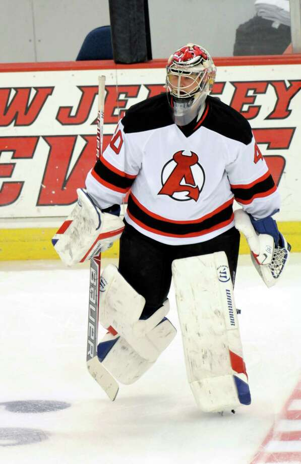 Albany Devils' goaltender Johan Hedberg takes practice before an AHL hockey game against the Adirondack Phantoms in Albany, N.Y., Saturday, Feb. 15, 2014. (Hans Pennink / Special to the Times Union) ORG XMIT: HP Photo: Hans Pennink / Hans Pennink