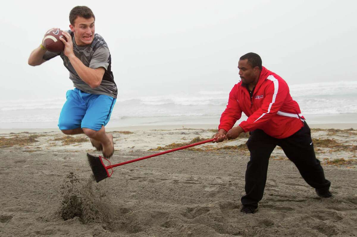 Not wanting to get swept up by his college successes, Johnny Manziel, left, works with a broom-wielding Hank Speights to hone his skills for the professional arena.