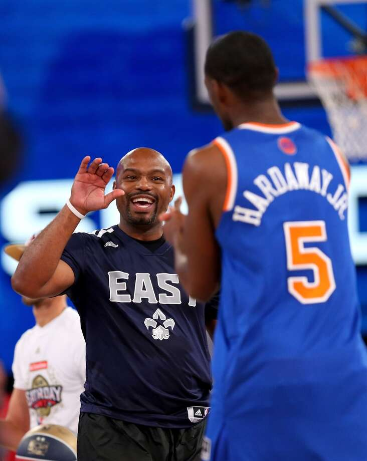NEW ORLEANS, LA - FEBRUARY 15: Eastern Conference All-Star Legend Tim Hardaway Sr. celebrates with Eastern Conference All-Star Tim Hardaway Jr. #5 of the New York Knicks during the Sears Shooting Stars Competition 2014 as part of the 2014 NBA All-Star Weekend at the Smoothie King Center on February 15, 2014 in New Orleans, Louisiana. NOTE TO USER: User expressly acknowledges and agrees that, by downloading and or using this photograph, User is consenting to the terms and conditions of the Getty Images License Agreement.  (Photo by Ronald Martinez/Getty Images) Photo: Ronald Martinez, Getty Images