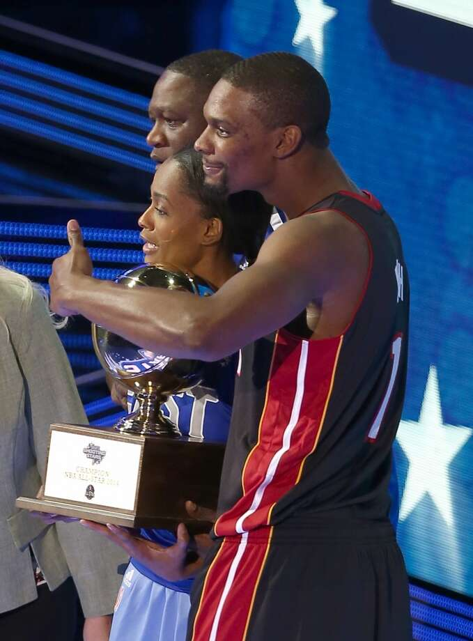 NEW ORLEANS, LA - FEBRUARY 15:  Eastern Conference All-Star Chris Bosh #1 of the Miami Heat Eastern Conference All-Star Legend Dominique Wilkins Eastern Conference WNBA All-Star Swin Cash #8 of the Chicago Sky accept a trophy for winning the Sears Shooting Stars Competition 2014 as part of the 2014 NBA All-Star Weekend at the Smoothie King Center on February 15, 2014 in New Orleans, Louisiana. NOTE TO USER: User expressly acknowledges and agrees that, by downloading and or using this photograph, User is consenting to the terms and conditions of the Getty Images License Agreement.  (Photo by Christian Petersen/Getty Images) Photo: Christian Petersen, Getty Images