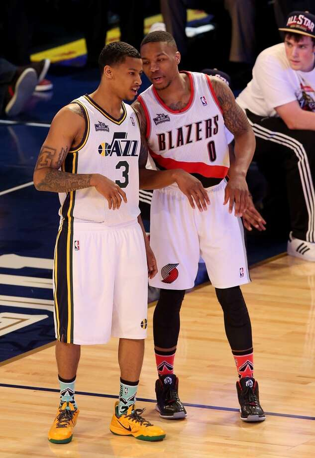 NEW ORLEANS, LA - FEBRUARY 15:  Western Conference All-Star Trey Burke #3 of the Utah Jazz and Damian Lillard #0 of the Portland Trail Blazers talk during the Taco Bell Skills Challenge 2014 as part of the 2014 NBA All-Star Weekend at the Smoothie King Center on February 15, 2014 in New Orleans, Louisiana. NOTE TO USER: User expressly acknowledges and agrees that, by downloading and or using this photograph, User is consenting to the terms and conditions of the Getty Images License Agreement.  (Photo by Christian Petersen/Getty Images) Photo: Christian Petersen, Getty Images