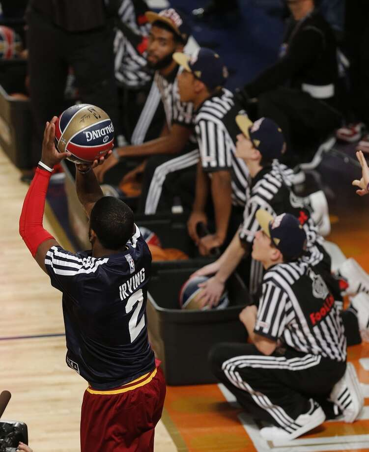 Kyrie Irving of the Cleveland Cavaliers shoots during the three-point contest during the skills competition at the NBA All Star basketball game, Saturday, Feb. 15, 2014, in New Orleans. (AP Photo/Bill Haber) Photo: Bill Haber, Associated Press