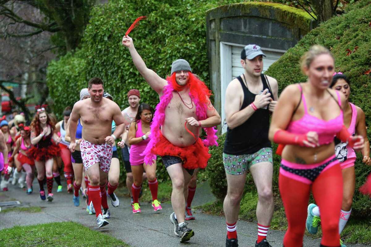 Participants make their way along North 39th Street during the third annual Cupid's Undie Run on Saturday, February 15, 2014 in Seattle's Fremont neighborhood.